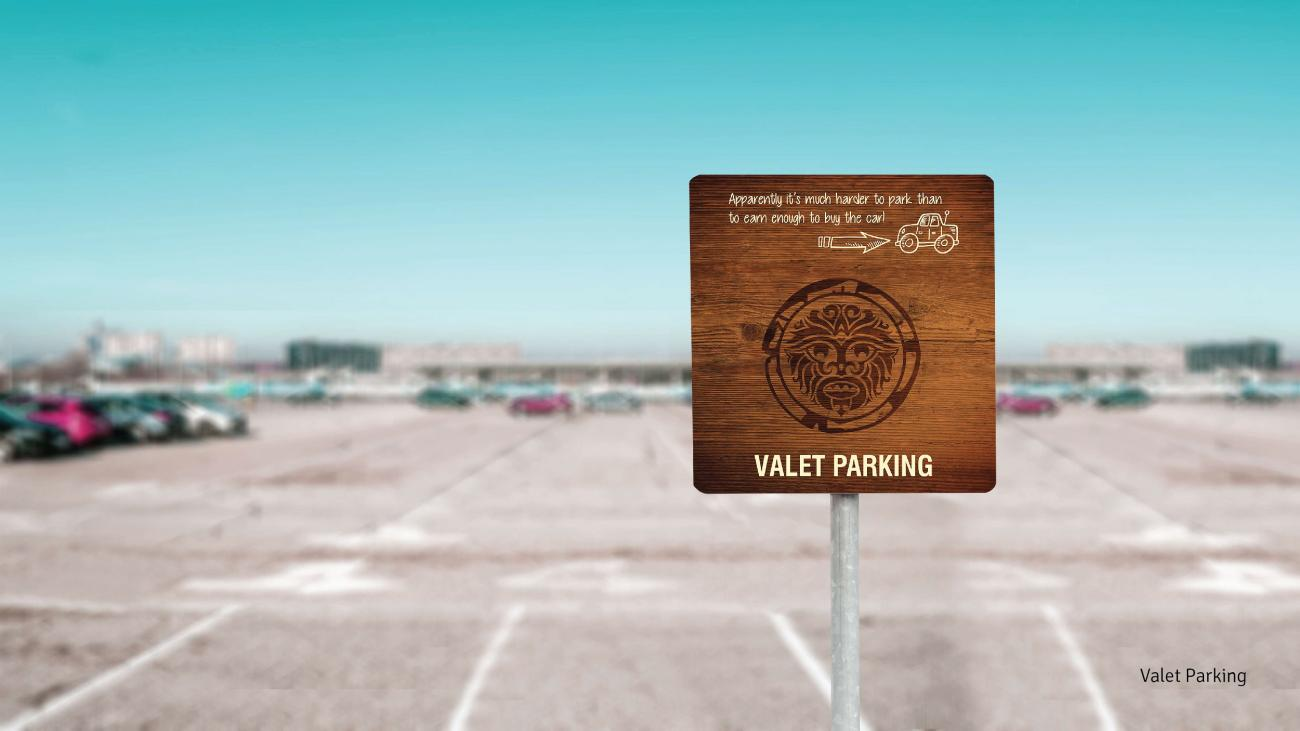 Valet parking signage as part of the branding for Three dots & a dash